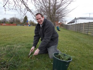 Keith planting snowdrops on Fordlands Field